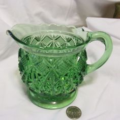 Vintage Green Glass Creamer-Pitcher cut glass diamond Ebay $29.99 - Mine has gold gilt accent on the inside of the top rim.