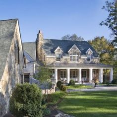 stone colonial with deep front porch