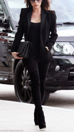 Victoria Beckham in yet another all black ensemble. Victoria Beckham bag, Walter Steiger boots