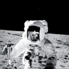 NASA PHOTO: AS-12-49-7278, REMASTERED by Dan Beaumont. NASA INFO: ( 19-20 Nov. 1969) --- Astronaut Alan L. Bean holds a Special Environmental Sample Container filled with lunar soil collected during the extravehicular activity (EVA) in which astronauts Charles Conrad Jr., commander, and Bean, lunar module pilot, participated. Conrad, who took this picture, is reflected in Bean's helmet visor. Conrad and Bean descended in the Apollo 12 Lunar Module (LM) to explore the lunar surface while a...