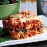 """Attention friends!! The idea that cooking a delicious lasagna for your family is time consuming and require you to spend hours in the kitchen is out the window! Slow cooked lasagna is easy breezy and delicious to boot! We even added some spinach for a little bonus veggie! Try this recipe with whole-wheat noodles to bump it up a """"healthy"""" notch! YUMMY YUMMY! And just so you know...this will feed a crowd!     Used 6-quart slow cooker"""