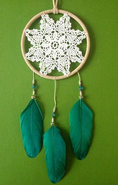 Crochet a flower, wood hoops, feathers. Gorgeous!