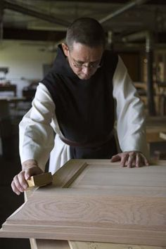 Watch a video of the Trappist Monks of New Melleray Abbey in their work of handcrafting fine wooden caskets, send for a free catalog and keepsake cross or download a free MP3 of the monks singing.