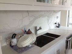 Stonepeak 'Plane' porcelain tile: oversized 5ft X10ft tile as countertop &  backsplash