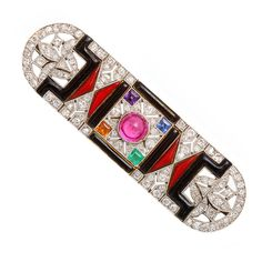 Art Deco diamond and black onyx brooch, set in platinum, the center embellished with a cabochon-cut natural ruby, with an emerald, sapphire, amethyst, and citrine in each of the four corners. France, ca. 1920.