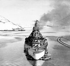 15 in battleship Tirpitz, Norway, winter 1943. Bismarck's sister spent most of the war there threatening the Arctic convoys but never coming to grips with them: RAF Lancaster bombers finally sank her after many previous air / underwater attacks in November 1944.