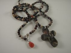 Semi-precious beads, agate cross and carnelian accent with sterling findings necklace by Marcia Etheridge