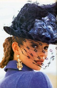 Kate Moss wearing a hat by Philip Treacy in Vogue Italia, October 1992.  Photo by Arthur Elgot.