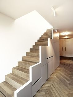 wooden staircase with storage underneath