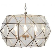 The Ritz Chandelier features tin and clear glass, creating an effortless look and just the right amount of light.