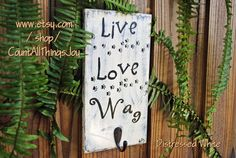 Live Love Wag and, yes, do walk! Leash Holder sign with single hook. Available in color of choice. Paw marks crossing the sign add a touch of whimsy! By CountAllThingsJoy