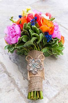 A colorful bouquet with a rustic touch.