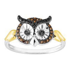 1/6 ct Black & Champagne Diamond Owl Ring in Sterling Silver and 10K Gold - 1/6 ct Black & Champagne Diamond Owl Ring: Get some style IQ points with this playful owl ring! Round-cut champagne and black diamonds, totaling 1/6 ct, decorate the face of the ring, crafted in sterling silver with 10K gold stylized feather accents on either side. Ring face measures 3/8 inches in width.
