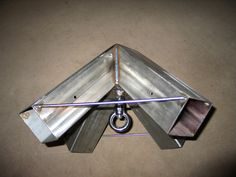bracket to use to hang repurposed trampoline bed from.  standard 4 X 4's fit into each leg and 'bed' hangs from center.
