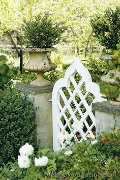 charming garden gate | gorgeous garden | plant in urn | green and white garden
