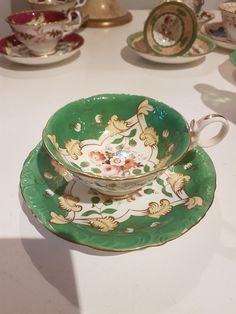 Antique handpainted cabinet cup and saucer floral bouquets green borders samuel alcock Murray Pollinger collection by AgoodvintageBoutique on Etsy