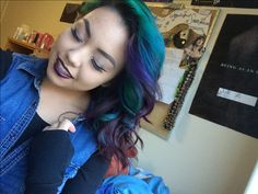 short hair, all purple with green, blue, and teal bangs