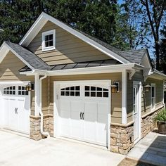 garage door with rounded windows and handles made to look like carriage doors Case Design/Remodeling, Inc. - traditional - garage and shed - dc metro - Case Design/Remodeling, Inc. Eldorado Stone, Shed Design, Door Design, House Design, Building Design, Design Room, Chair Design, Design Exterior, Exterior House Colors
