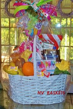 White wicker basket filled with assorted seasonal fru. White wicker basket filled with assorted seasonal fruit and lots of asso Birthday Gift Baskets, Birthday Gifts, Simple Wedding Centerpieces, White Wicker, Fruit In Season, Fruit Snacks, Simple Weddings, Wedding Themes, Birthday Candles