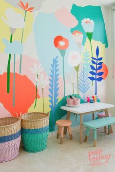 Flower mural. Garden wallpaper. Dip painted furniture. Playroom ideas. Striped baskets.