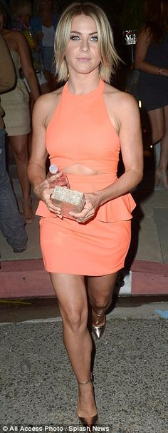 Once a dancer: Julianne could not resist playfully tossing her bag to the beat as she left the venue