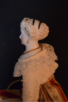 Here is a beautiful old Parian Doll. The doll has a crazy wonderful hair style, there are curls in the front and side and back with a large curly bun. Old Dolls, Antique Dolls, Curly Bun, China Dolls, Antique China, Doll Head, Ruby Lane, French Fashion, Old And New