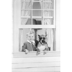 Boy with dog looking through window portrait Canvas Art - (18 x 24)
