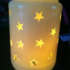 Empty jar + stickers + spray paint + tea candle= cool glass candle