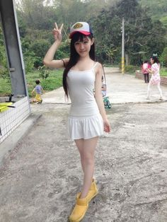 Sexy and busty Filipina babe giving everyone the peace sign wearing a hot white dress