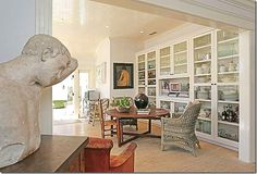 Glass front cabinets in eat-in kitchen; love the glossy beadboard ceiling- Brenda Antin/Lena Dunham LA home
