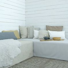 Daybed covers in Unbleached Linen and A Paler Shade of Grey and cushions in Zinc Grey, Caffe Latte, Bolster Stripe, Soft White and Sage Brown all from Bemz