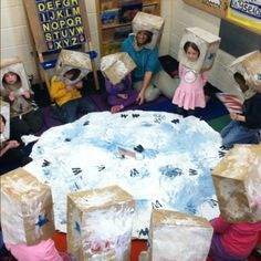 "Awesome Preschool trip to the moon! Butcher paper moon with sponge-painted craters & ""astronauts"" wearing their paper bag helmets & waving their Popsicle stick & paper American flags! Talk about one giant leap! So fun!!"