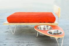 omg this would be so easy to diy with an old couch cushion, a slab of wood and some cabinet knobs for legs. i'm on it.
