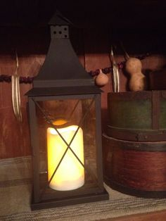 Primitive battery operated lantern and candle on timer. Nice flat black metal and glass. $36.99 at *The Farm* 217-742-5050,