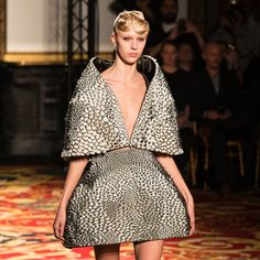 Dutch designer Iris van Herpen debuted two 3D-printed outfits made in collaboration with US-based designer Neri Oxman and Austrian architect Julia Koerner during her runway show at Paris Fashion Week yesterday.