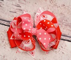 A personal favorite from my Etsy shop https://www.etsy.com/listing/119731621/valentines-day-hairbow-pink-red-heart