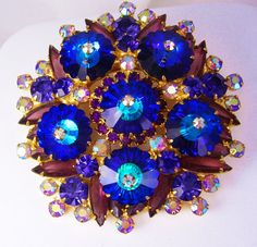 HUGE Juliana Brooch Rivoli rhinestones blue purple aurora borealis Show stopper. BEYOND fabulous and massive in size, this brilliantly colored rhinestone brooch is loaded with layers of navettes, rounds, and huge rivoli glass stones. The photos don't do this beauty justice.