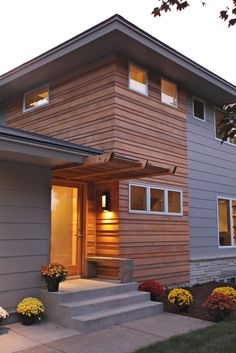 Yummy, simple exterior We remodeled this entire home, keeping only a few walls to comply with setback requirements. The exterior is a combination of clear shiplap cedar, stone, aluminum and Hardie Plank siding. Cedar Siding, Wood Siding, Exterior Siding, Exterior Remodel, Exterior House Colors, Wood Paneling, Hardie Board Siding, Shiplap Siding, Ranch Exterior