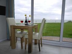 A drink or a meal with such a fabulous sea view through the patio doors! California near Great Yarmouth UK Great Yarmouth, Holiday Accommodation, Outdoor Furniture Sets, Outdoor Decor, Patio Doors, Dining Table, Meal, California, Drink