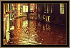 Jenny Rainbow Fine Art Photography Framed Print featuring the photograph Golden Hour In Amsterdam. Reflections by Jenny Rainbow
