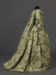 Side view, robe à la francaise, 1750-1760. Green silk lampas with white floral motifs and leafs.