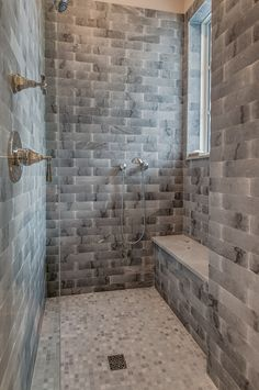 This master bathroom features a walk in shower with a partial