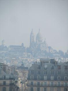 Paris, France - view from downtown Paris of Montmartre hill and the Basilique du Sacre'-Coeur.