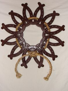 Google Image Result for http://www.rustic-country-creations.com/uploads/Horseshoe_Wreath.jpg