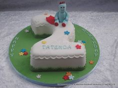 Number 2 Cake Iggle Piggle. Number 2 numerical shaped 2nd birthday cake with Iggle Piggle adorning the top. Simple bright coloured flowers to finish of the cake