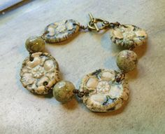 by Sheri Mallery Unique porcelain floral and green garnet by SheriMalleryHandwork.etsy.com    $42.00