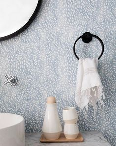 This bathroom is from the home of @masonliff designed by @thehoneybluesstudio for @parachutehome. We're thrilled at how our Speckled Wallpaper in Cloud Blue transformed this bathroom. See more on Parachute's blog. Photo by @monicawangphoto. #rebeccaatwood #RAwallpaper