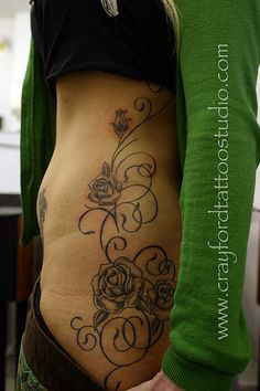 #Roses and swirls Tattoo