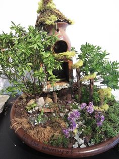 Recycle Reuse Renew Mother Earth Projects: like the old pot transformed to multi floor faerie house