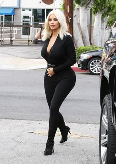 Kim Kardashian wearing very tight black pants (X-post /r/KimKardashianPics)